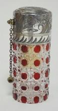 RUBY CUT TO CLEAR PERFUME ATOMIZER W/ SILVER PLATED TOP. NOZZLE HAS A SCREW ON CAP ON A CHAIN. 5 1/2 IN H