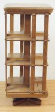 REVOLVING OAK BOOKCASE. 44 IN TALL & 20 IN SQUARE.
