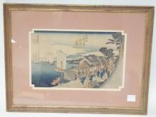 SIGNED, FRAMED JAPANESE WOODBLOCK PRINT. BOATS IN A HARBOR AND PEOPLE ON A VILLAGE STREET. 13 1/2 IN X 8 1/2 I N