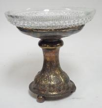 CUT CRYSTAL BOWL IN A SILVER PLATED HOLDER. 9 1/4 IN DIA, 9 1/4 IN H