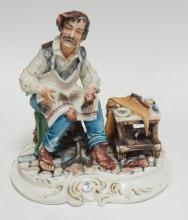 CAPODIMONTE FIGURINE OF A COBBLER. 9 1/4 IN HIGH.