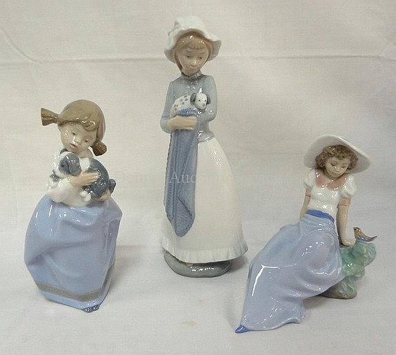 GROUP OF 3 NAO FIGURES, GIRLS; 2 HOLDING PUPPIES,