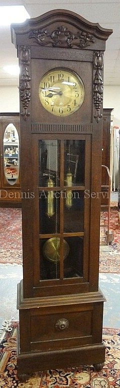 FRUIT CARVED OAK TALL CASE CLOCK; BRASS FACE MARKED P.C.; 85 1/4 IN H