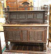 ANTIQUE INTRICATELY CARVED OAK SIDEBOARD WITH A HIGH BACKSPLASH. 59 INCHES WIDE. 66 1/2 INCHES HIGH.