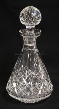 WATERFORD LISMORE PATTERN DECANTER WITH STOPPER. 10 5/8 INCHES HIGH. RIM HAS THE TINIEST FLEA BITE ON THE EDGE.