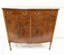 FIGURED MAHOGANY BOW FRONT SIDEBOARD WITH BANDED EDGES AND LINE INLAY. 2 DRAWERS OVER 2 DOORS. 42 1/4 INCHES WIDE. 41 3/43 INCHES HIGH.