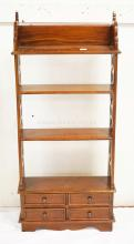 SMALL MAHOGANY SHELF UNIT WITH 4 DRAWERS AT THE BOTTOM AND OPENWORK SIDES. 43 INCHES HIGH. 19 3/4 INCHES WIDE.