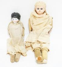 2 19TH CENTURY DOLLS. ONE CHINA HEAD AND ONE TIN HEAD. TALLEST IS 16 INCHES.
