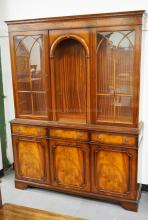 2 PIECE MAHOGANY BREAKFRONT WITH FIGURED VENEERS AND CATHEDRAL STYLED FRETWORK ON THE DOORS. 76 INCHES HIGH. 57 INCHES WIDE.
