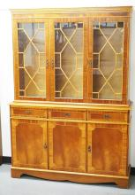 2 PIECE MAHOGANY BREAKFRONT WITH 3 GLASS DOORS AND BANDED DECORATION. 76 1./2 INCHES HIGH. 54 1/2 INCHES WIDE.