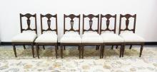 SET OF 6 CARVED MAHOGANY CHAIRS WITH URN BACKS. 18 INCHES WIDE. 37 INCHES HIGH.