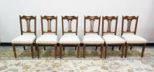 SET OF 6 CARVED OAK DINING CHAIRS. SEATS HAVE A COUPLE STAINS. 18 INCHES WIDE. 37 INCHES HIGH.