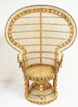 1970'S WICKER PEACOCK CHAIR WITH A CANED SEAT. 44 INCHES WIDE. 58 INCHES HIGH.