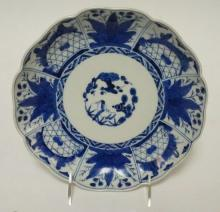 CHARACTER SIGNED BLUE AND WHITE BOWL. 8 1/2 IN H