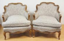 PAIR OF FLORAL CARVED UPHOLSTERED ARM CHAIRS