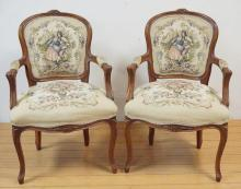 PAIR OF FLORAL CARVED PARLOR CHAIRS W/ FLORAL AND SCENIC UPHOLSTERY