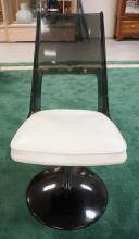DAYSTROM FURNITURE MID CENTURY MODERN SMOKY LUCITE CHAIR WITH A METAL SWIVEL BASE AND A CUSHIONED SEAT. 34 INCHES HIGH.