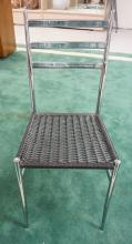 MID CENTURY MODERN CHROME CHAIR WITH A VINYL COVERED WOVEN SEAT. 35 1/2 INCHES HIGH.