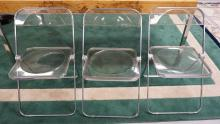 3 MID CENTURY MODERN LUCITE AND CHROME FOLDING CHAIRS. EACH WITH WEAR.