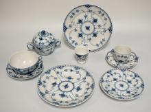 7 PIECES ROYAL COPENHAGEN BLUE FLUTED LACE PORCELAIN. INCLUDES A COVERED SUGAR, 2 CUPS AND SAUCERS, AN EGG CUP, 2 PLATES, AND ONE SMALLER PLATE.