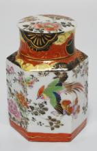 ASIAN PORCELAIN HEXAGONAL JAR WITH INTERIOR AND EXTERIOR LID. HAND PAINTED WITH BIRDS AND FLOWERS. CHARACTER SIGNED. SOME CHIPPING TO THE RIM OF THE JAR. 6 INCHES HIGH.
