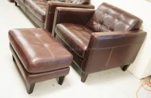 BROWN TUFTED LEATHER LOUNGE CHAIR AND OTTOMAN.