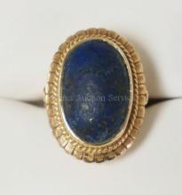 10K GOLD (TESTED) RING WITH A LARGE OVAL UNPOLISHED LAPIS? 4.75 DWT.