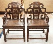 PAIR OF CARVED ASIAN HARDWOOD ARMCHAIRS.