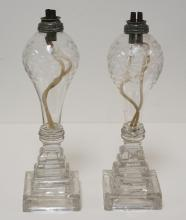 PAIR OF FLINT GLASS WHALE OIL LAMPS WITH ETCHED LEAVES AND BERRIES. SOME BASE CHIPS. 10 1/2 INCHES HIGH.