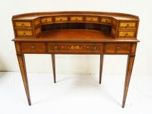 MAHOGANY CARLTON DESK WITH INLAID DECORATION AND VARIOUS GRAINED VENEERED PANELS. LEATHER TOP. 43 1/2 INCHES WIDE. 37 1/2 INCHES TALL.