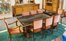 11 PIECE DINING ROOM SET BY *MOBILE DI CANTU* ITALY. SUPERIOR QUALITY BENCH MADE FURNITURE. SET INCLUDES A CHINA CABINET, SIDEBOARD WITH MIRROR, A TABLE & 8 CHAIRS. FEATURING ORNATELY CARVED LEGS, LINED INLAY AND BURLED PANELS, AND GOLD STENCILED BLACK GLASS TOPS.