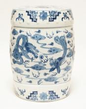 ASIAN PORCELAIN GARDEN SEAT. BLUE DECORATION OF DRAGONS WITH PEARLS. 16 INCHES TALL.