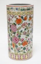 ASIAN PORCELAIN UMBRELLA STAND WITH POLYCHROME DECORATION OF FLOWERS. 17 1/2 INCHES TALL.