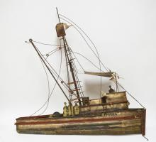 CURTIS JERE SIGNED METAL SCULPTURE OF A FISHING BOAT. 30 1/2 INCHES LONG. 30 INCHES TALL.