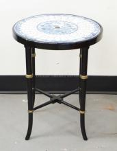 ASIAN STAND WITH A BLUE & WHITE DECORATED PORCELAIN TOP SUPPORTED BY A BAMBOO TURNED BLACK AND GOLD BASE. 19 INCHES TALL. 15 1/2 INCH DIA.