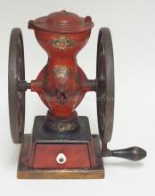 ENTERPRISE DOUBLE WHEEL COFFEE GRINDER. 12 1/2 IN HIGH. HAS ORIGINAL DECORATION IN VERY NICE CONDITION & NO EXCESSIVE WEAR.