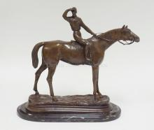 BRONZE THOROUGHBRED HORSE & JOCKEY BY P.J. MENE ON MARBLE BASE. 13 3/4 IN TALL. 15 1/2 IN LONG.