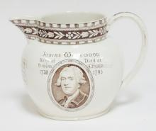 JOSIAH WEDGWOOD COMMEMORATIVE PITCHER. HAS A PORTRAIT ON THE FRONT AND THE *PORTLAND VASE* ON THE BACK. 5 IN TALL. IMPRESED *WEDGWOOD* ON THE BOTTOM.