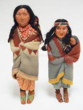 2 SKOOKUM INDIAN DOLLS. 12 1/2 IN TALL. 1 MARKED, 1 UNMARKED.