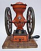 ENTERPRISE NO. 2, TWO WHEEL COFFEE GRINDER; 8 3/4 IN WHEELS; MOUNTED ON A BEVELLED OAK BASE