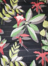 LARGE BOLT OF MID C. FABRIC. FLOWERS AND LEAVES ON A BLACK GROUND. 10 YARDS X 47 IN