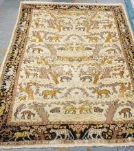 ORIENTAL RUG WITH A VARIETY OF BIRDS AND ANIMALS. 5 FT 1 IN X 6 FT 7 IN