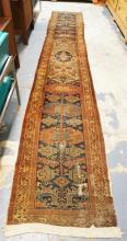 ORIENTAL RUNNER. HAS WEAR SPOTS. 2 FT 5 IN X 14 FT 10 IN