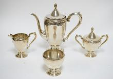 37.50 TROY OZ 4 PIECE STERLING SILVER TEA SET. TALLEST PIECE MEASURES 10 INCHES. SOME SMALL DENTS.