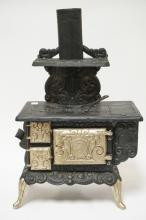 FAVORITE CAST IRON SALESMAN'S SAMPLE STOVE. 17 1/4 IN WIDE, 27 1/4 IN H.