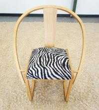MID CENTURY MODERN CHAIR WITH A HOOP BACK AND ZEBRA STRIPED SEAT. 34 INCHES TALL.