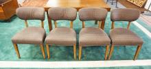 SET OF 4 MID CENTURY MODERN DINING CHAIRS. 31 INCHES TALL. 20 INCHES WIDE.