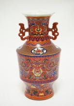 ASIAN PORCELAIN DOUBLE HANDLED VASE. DECORATED WITH FLOWERS AND DRAGONS. 9 3/4 INCHES TALL.