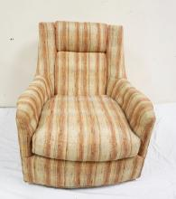UPHOLSTERED SWIVEL LOUNGE CHAIR.