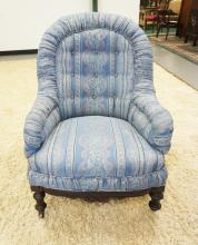 CARVED & UPHOLSTERED LOUNGE CHAIR. 37 INCHES TALL.